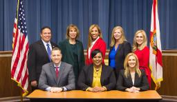The Hillsborough county public school board members smile at the camera
