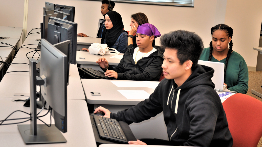 Guilford students work on desktop computers