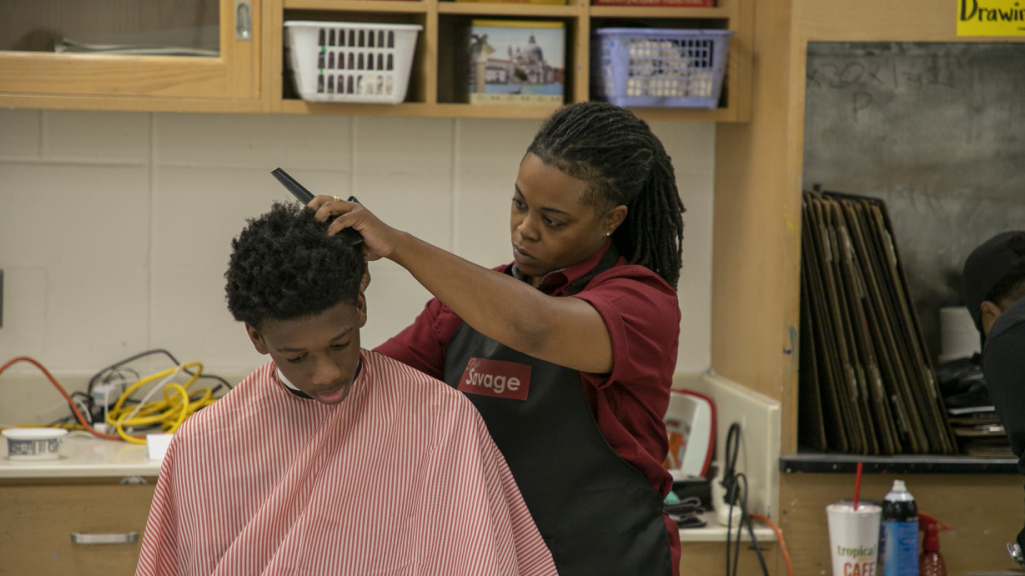 a student receives a haircut
