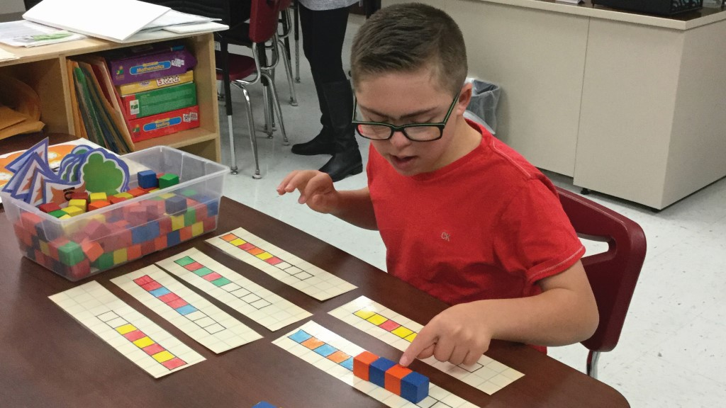 A Boyce Middle School student working on one-to-one math skills and continuing patterns in a resource classroom.