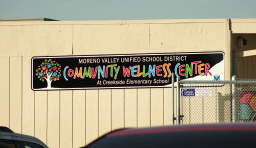 "a sign that reads ""community wellness center"""
