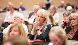 an advocacy institute attendee listens to presentations