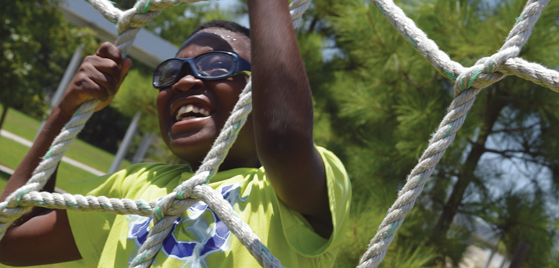 A child on a rope course